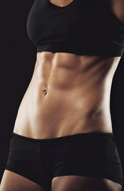 Showing some strong abs and flat belly stock photo
